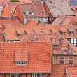 Facing at the red roofs of the medieval city Quedlinburg in Germ — Stock Photo