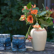 Still life of vases and flowers at a garden table — Stock Photo #7561513