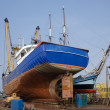 Fish cutter repaired at dutch shipyard - Stock Photo