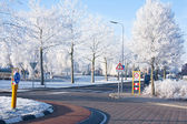 Residential area with traffic circle in wintertime — Stock Photo
