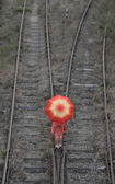 Girl with umbrella on railway tracks — Stock Photo