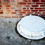 The white manhole — Stock Photo #7803639