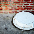 Stock Photo: White manhole
