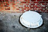 The white manhole — Stock Photo