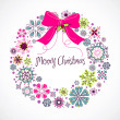 Colourful Christmas wreath made from snowflakes - Stock Photo