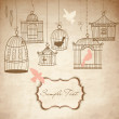 Vintage bird cages. Birds out of their cages - Stock Photo