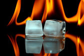 Ice cubes and fire — Stock Photo