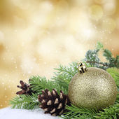Christmas bauble border on golden background — Stock Photo