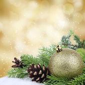 Christmas bauble border on golden background — Stock Photo