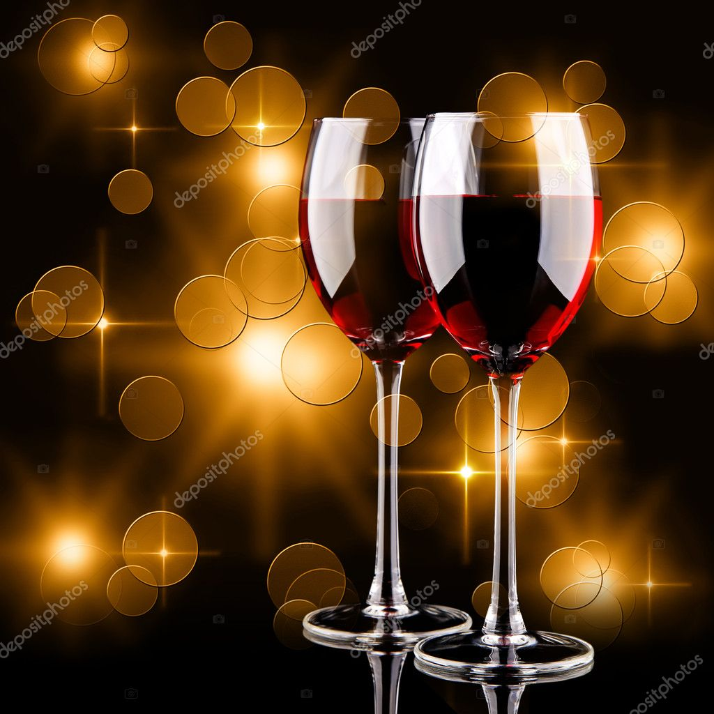 Glasses of red wine and bokeh lights on a black background — Stock Photo #7508406