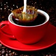 Cup of coffee with milk splash — Stock Photo #7810212
