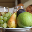 Breakfast for a couple - fresh fruits and juice — Stock Photo