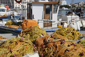 Fish nets in Tinos harbour — Stock Photo