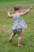 Baby first steps — Stock Photo