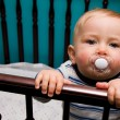 Baby with pacifier — Stock Photo #7505386