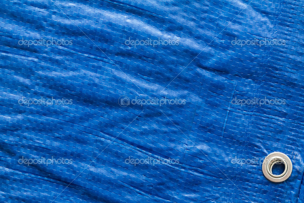 Blue tarp or waterproof tarpaulin — Stock Photo #7505754