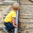 Boy playing on track — Stock Photo
