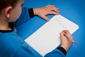 Boy writing to Santa — Stock Photo