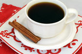 Hot Coffee with Cinnamon Sticks — Stock Photo