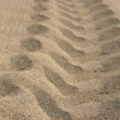 Tire track on the sand. — Stock Photo #7569864