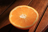 Half an orange on the table. — Stock Photo