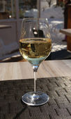 Single glass of white wine on the table. — Stock Photo