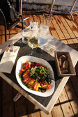 Light lunch in the open-air restaurant (top view). Sunny winter — Stock Photo