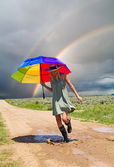 Girl and a rainbow — Stock Photo