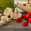 Garlic, cherry tomatoes, crimini mushrooms... — Stock Photo