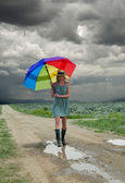 Girl & rainbow umbrella — Stock Photo