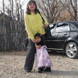 Native Americwomwith her daughter — Stockfoto #7496650
