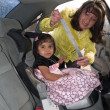 Native American girl in a child safety seat — Stock Photo #7496668