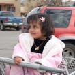 Cute Native American girl sitting in a shopping cart — Stock Photo #7496715