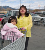 Native American woman heading to a grocery store — Stock Photo