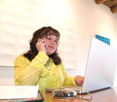 Native American woman on a cell phone in office — Stock Photo