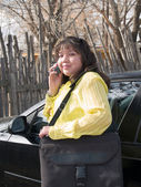Native American woman talking on a cell phone — Stock Photo