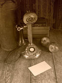 Old phone and a blank note — Stock Photo