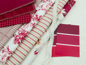 Red & white fabric and paint swatches — Stock Photo