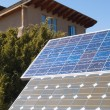 Solar panles in front of a private home - Stock Photo