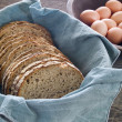 Stock Photo: Fresh whole wheat bread and eggs