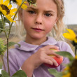 Little girl holding apple — Stock Photo #7524829