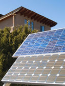 Solar panles in front of a private home — Stock Photo