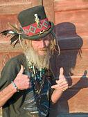 Eccentric senior man thumbs up — Stock Photo