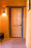 Wooden door in an adobe home — Stock Photo