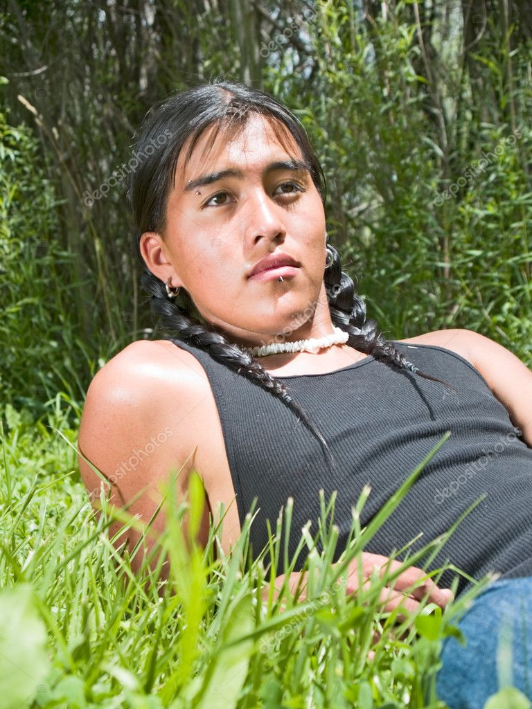 Handsome 15 year old Native American boy relaxing on lawn — Stock Photo #7524558