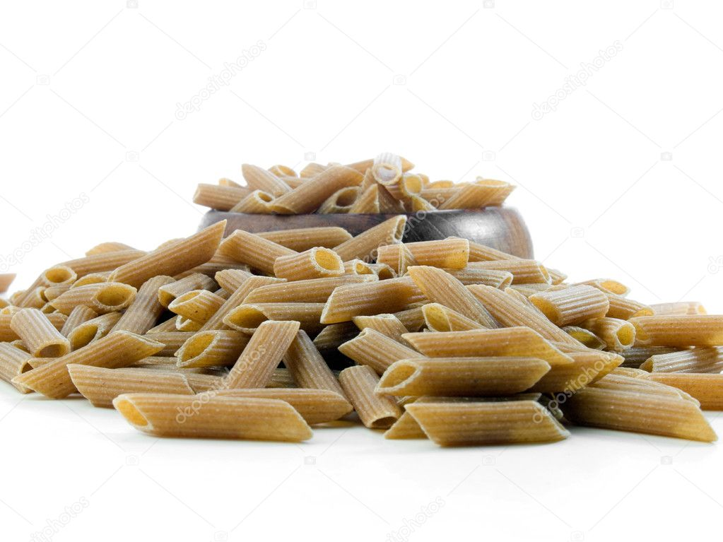 Whole wheat penne pasta isolated on white — Photo #7524596