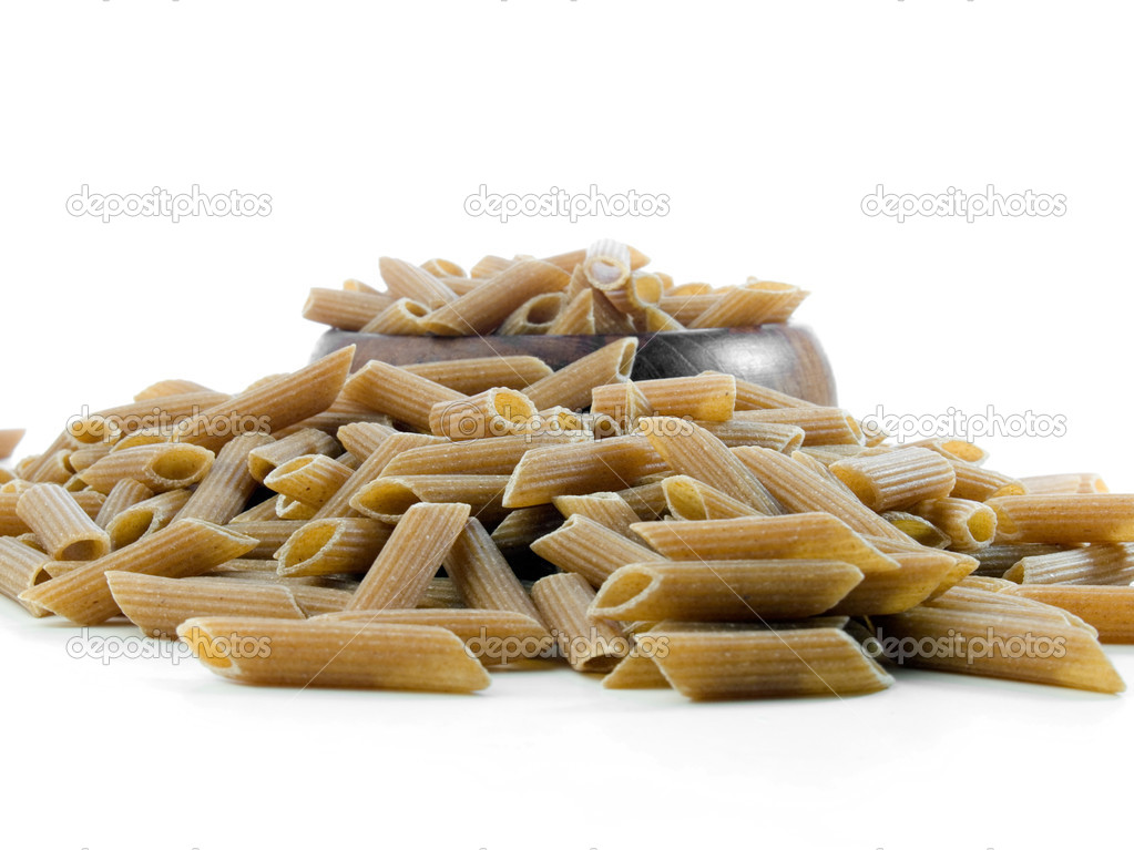 Whole wheat penne pasta isolated on white — Foto de Stock   #7524596