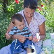 Stock Photo: Mother giving homeoptahic medicine to her son