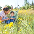 Mother and son enjoying late summer afternoon — Stock Photo