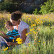 Stock Photo: Mother and son reading a book together